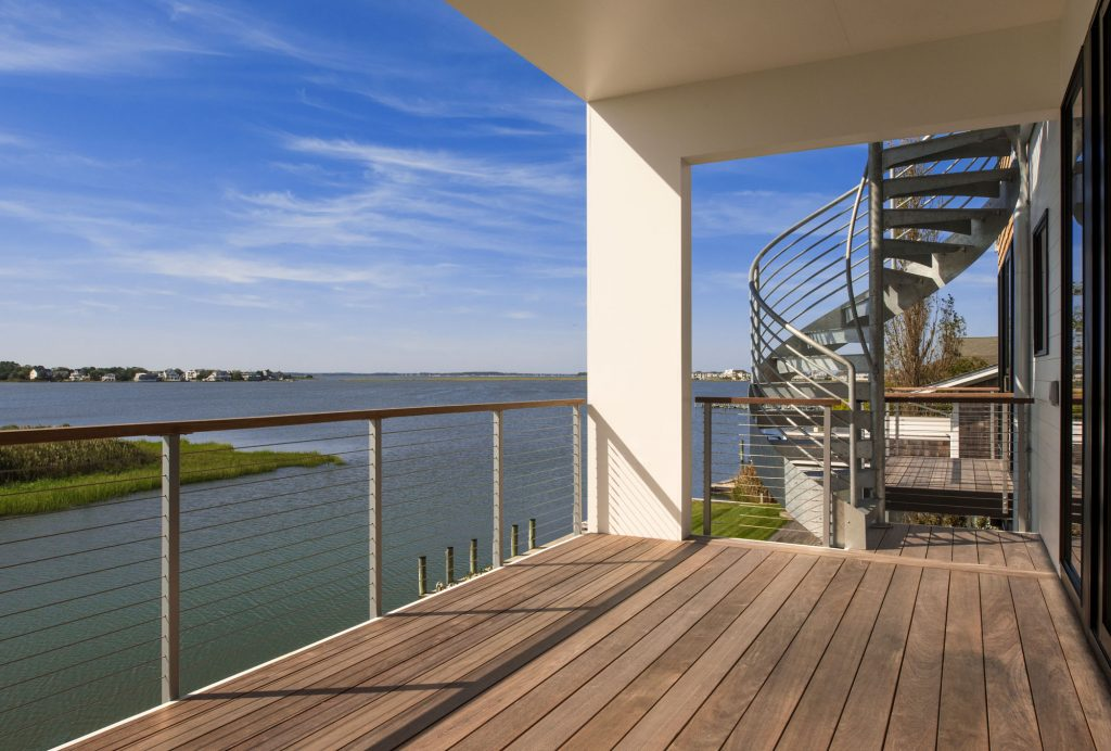 With its white elevated porch steps, airy spiral staircase and multiple decks, this home takes advantage of views, sun patterns and prevailing winds off the Bay.