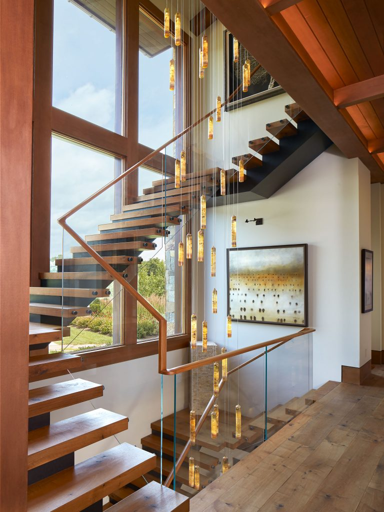 Custom two-story interior feature steel  stair with glass guardrail, wood treads,  and wood landings.  Architecture: Purple Cherry Architects Custom Builder: Pyramid Builders Photographer: Anice Hoachlander