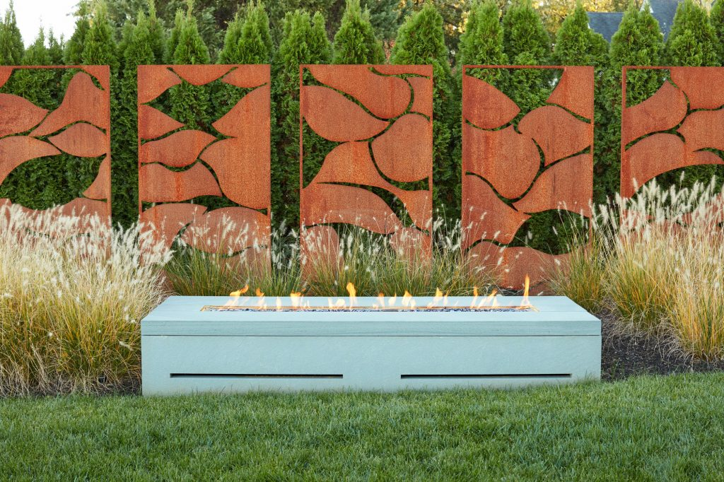 Exterior weathering steel privacy screens with laser cut leaf motif.  Landscape Architecture: Campion Hruby Landscape Architects Custom Builder: Pyramid Builders Photographer: David Burroughs