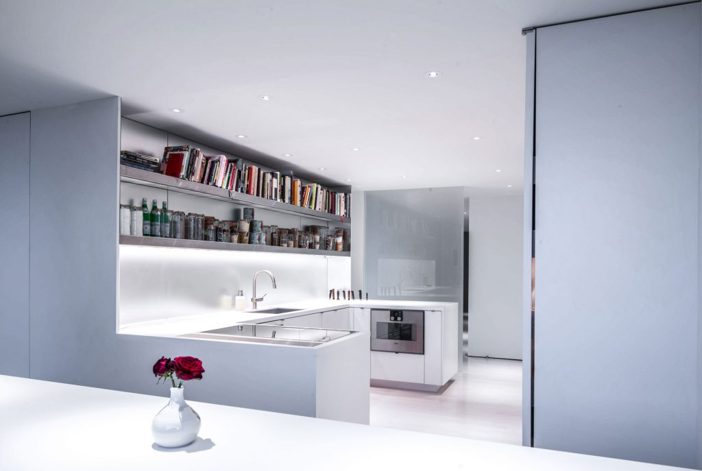 Intent on preserving sightlines to the rest of the living area and the stunning views beyond, the kitchen was the most architecturally challenging space to tackle. Visually it reflects the tone of the adjacent spaces.