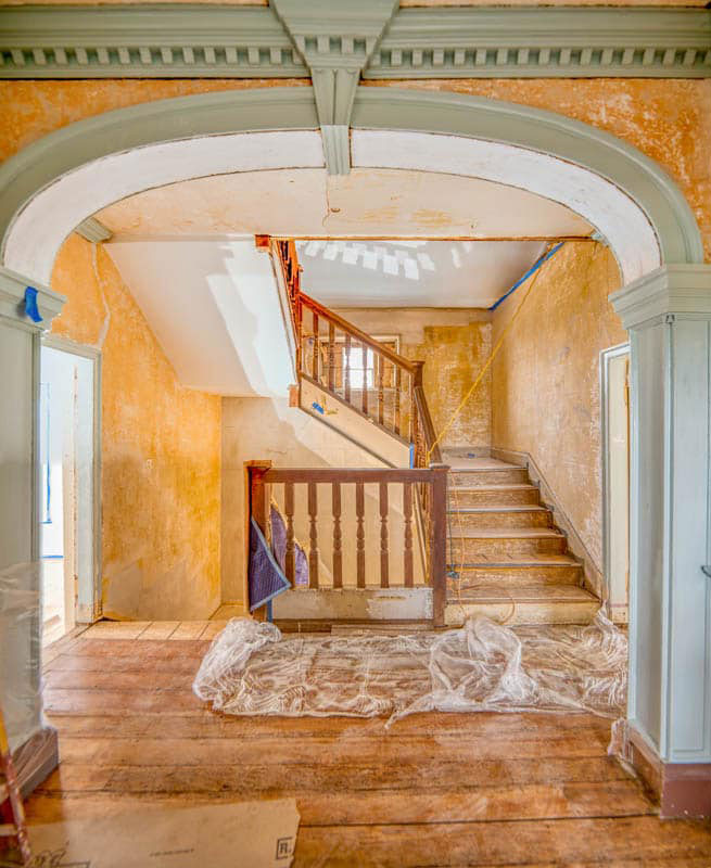 William Hemsley updated his grandfather's house with stylish woodwork that included this elliptical arch with keystone rising up to engage the cornice, but elected to retain the original walnut staircase.