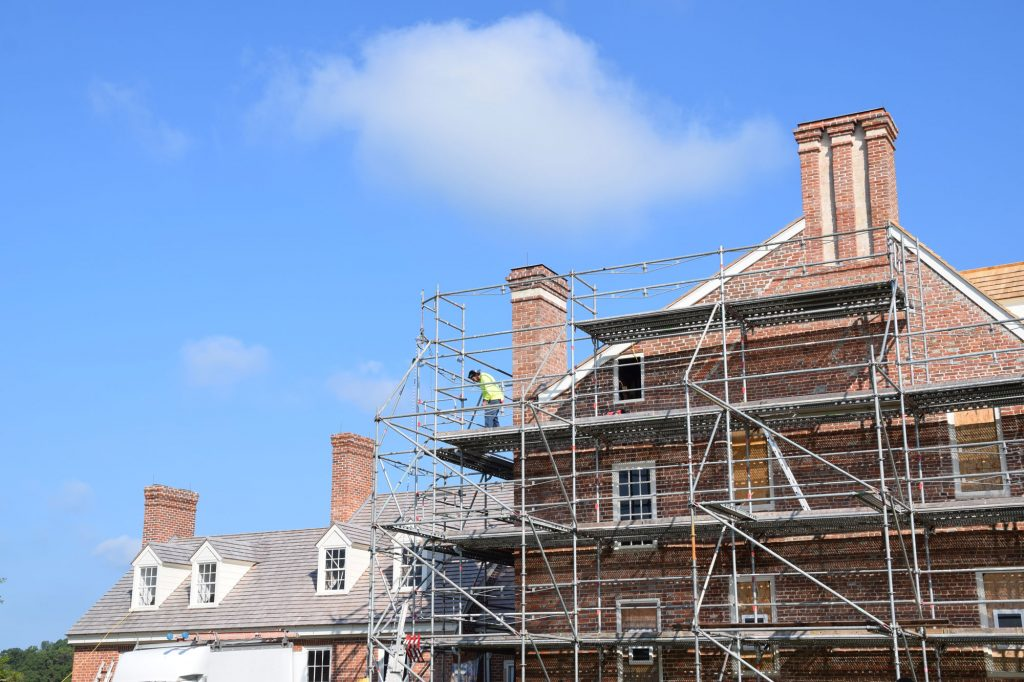 Expert mason Raymond Cannetti oversaw the careful removal of residual paint and made repairs to the 1705 brickwork.