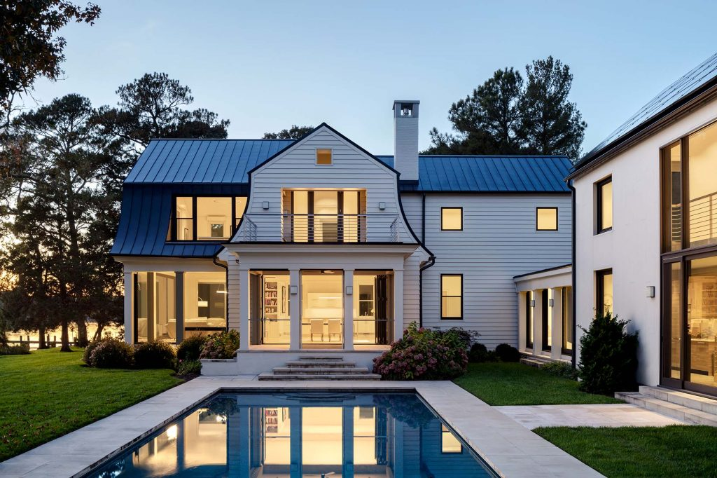 The home's traditional elements include a variation of the gambrel roof,  which distinguishes many early 20th-century shingle-style homes.