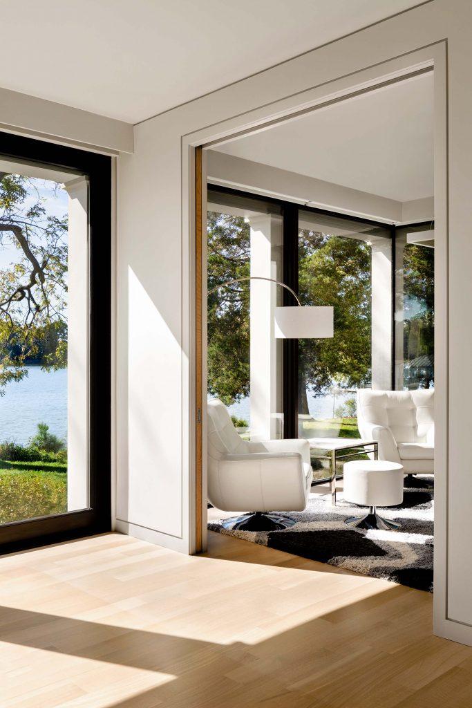 Black trimmed casement windows unify farmhouse, guest quarters, and breezeway.