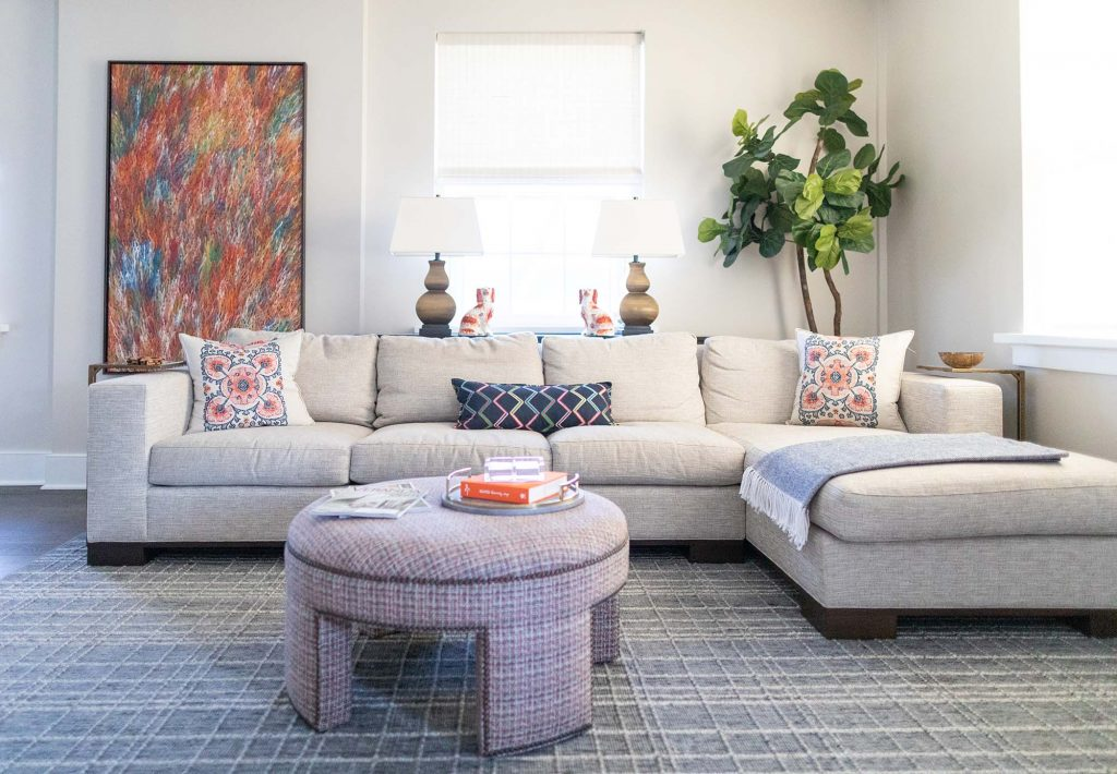 Colorful artwork, neutral furniture, patterned rug and carefree pastels ensure this space is calming yet visually stimulating.