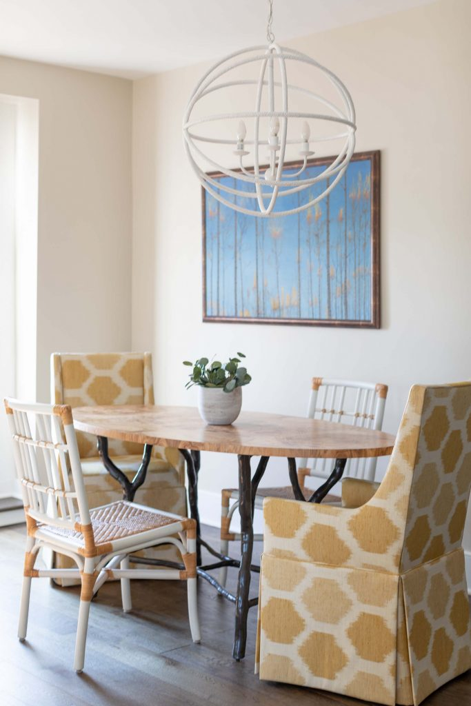 When the homeowners downsized, all they kept from their old home was their art collection, which would become the focus of the design in their new home.