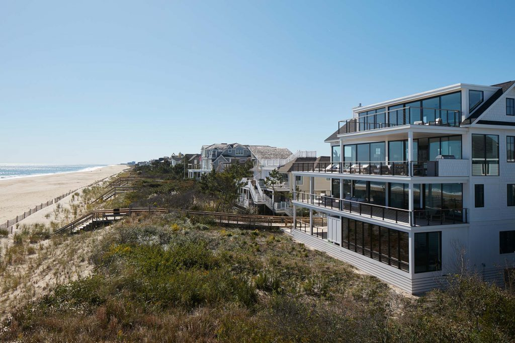 Surfside's four stories of floor-to-ceiling glass are  treated with low-heat glaze that blocks UV light  and makes it easier to keep the house cool.