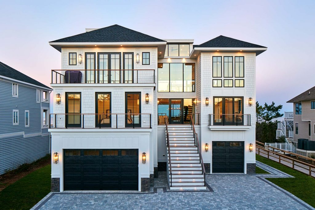 Even with four stories, Surfside maintains the traditional  aesthetic of a nuevo-coastal cottage from the front.