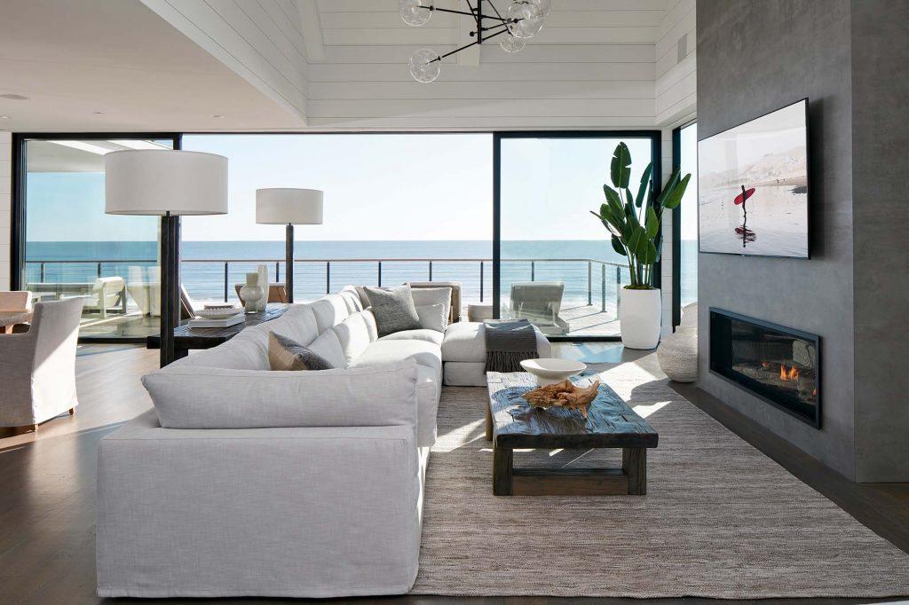 Surfside's open floor plan is broken up into separate living spaces by lighting and furniture arrangements.