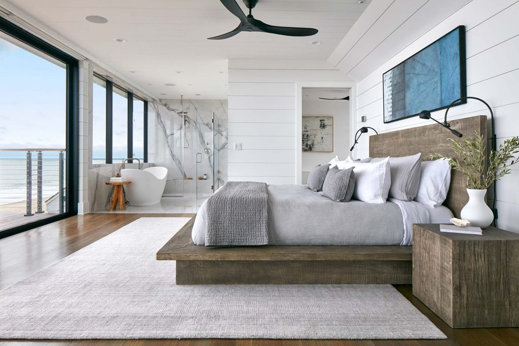 Unfinished wood and lots of white give  the interior design an airy, beachy feel.