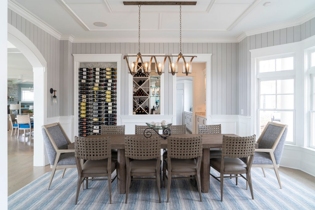 Formal chandeliers, some with dangling  crystals, were swapped for a simple, fun  modern light fixture.