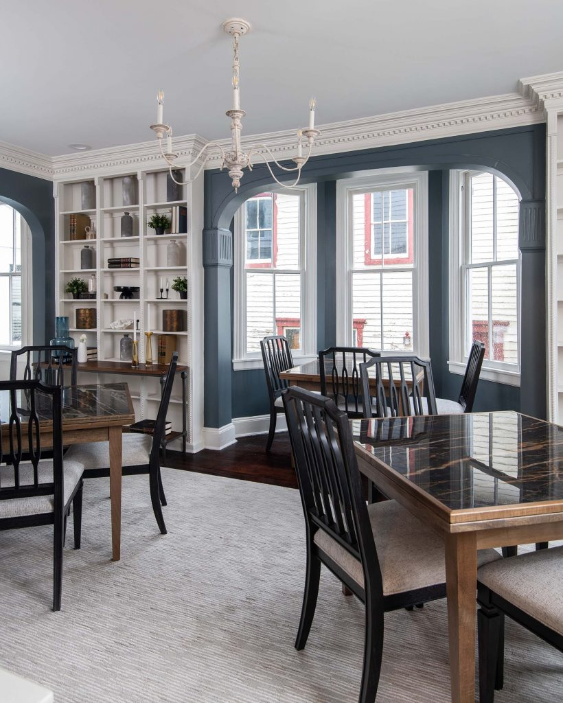 By removing clutter and all window treatments, this room's elegant molding and unusual trim take center stage.